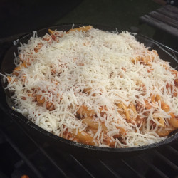 Topping the Penne with Cheese